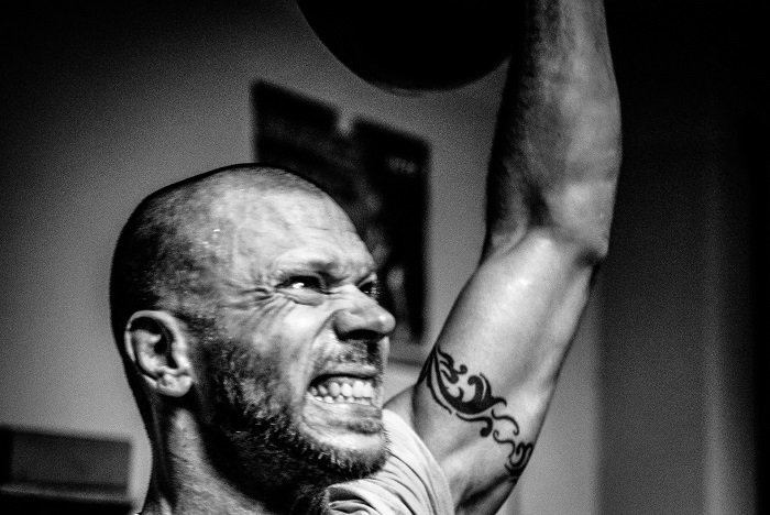 Kettlebell Workouts for Beginners single arm kettlebell overhead press